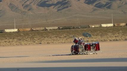 Train passing drum kit isolated in desert