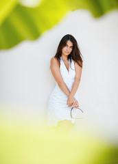 Portrait of elegant woman against white background