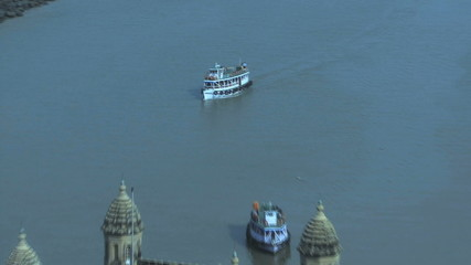 Zoom out on boats in front of gateway of india elevated view