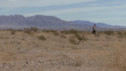 Male running through desert