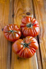 oxheart tomato on wood
