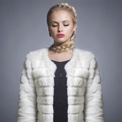 Beautiful blond woman in Fur Coat