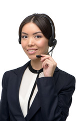 Asian call center female operator with headphones