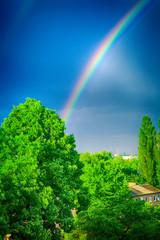 rainbow in dark blue sky