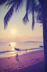 Retro instagram style filtered picture of beach at sunset.
