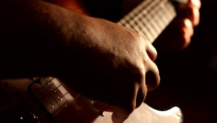 Electric Guitar Playing Shadows