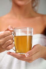 Herbal tea in woman's hands