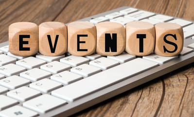 THE WORD events in wooden block dice