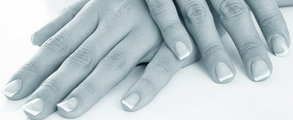 Young woman hands with french manicure
