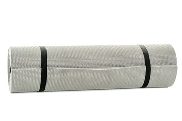 Multipurpose mat rolled up and secured