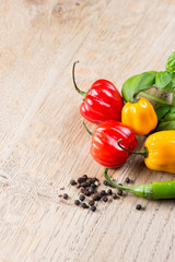 Peppers and tomato on table with copy space