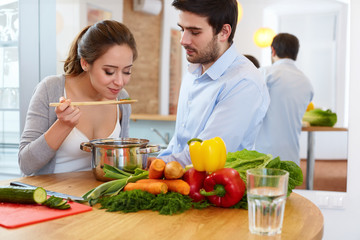 Couple Cooking Food in Kitchen. Healthy lifestyle