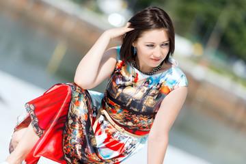 Model in dress posing on exterior set angled
