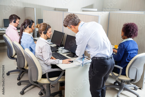 Manager Assisting Customer Service Agent In Call Center - 79634064