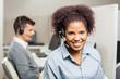 Smiling Female Customer Service Representative In Office - 79634235