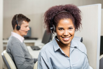 Smiling Female Customer Service Representative In Office