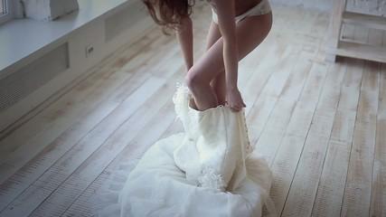 Wedding morning, bride taking wedding dress, getting ready