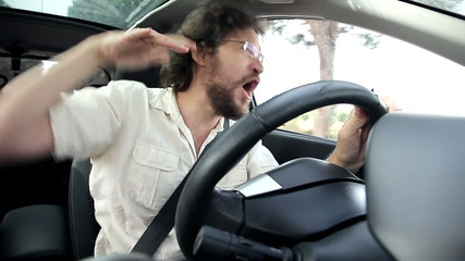 Man having fun in car dancing while driving