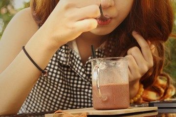 Women drinking iced cacao in the coffee shop.