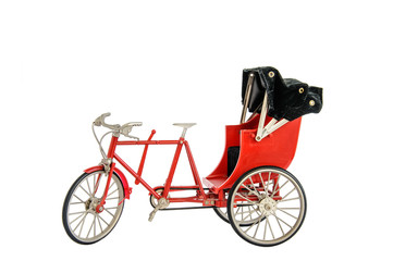 Red color vintage oriental rickshaw cab, miniature
