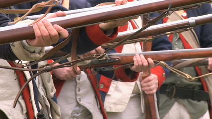 Soldiers line up during a revolutionary war battle reenactment