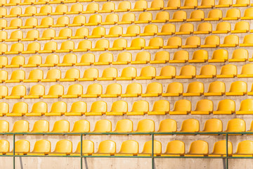 yellow chairs on the soccer field