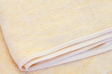Close - up Clean yellow towel texture and seamless background