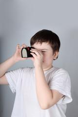 Boy looks in filmoskop