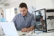 Leinwanddruck Bild - Technician fixing computer hardware