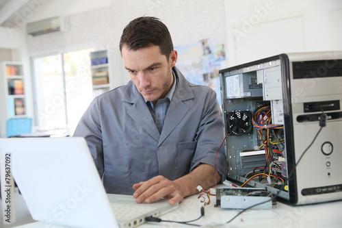 Technician fixing computer hardware - 79637092