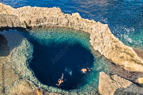 Deep blue hole at the world famous Azure Window in Gozo Malta - 79637464