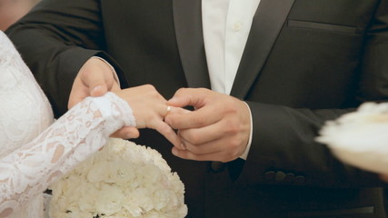 Exchange of wedding rings at wedding ceremony