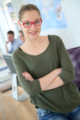 Portrait of trendy student girl with eyeglasses on