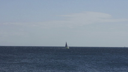 Yacht sailing in the blue sea