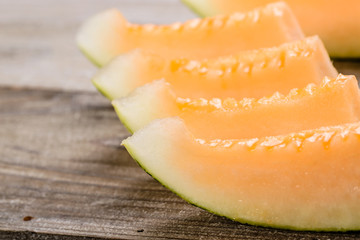 melon pieces on the wooden board