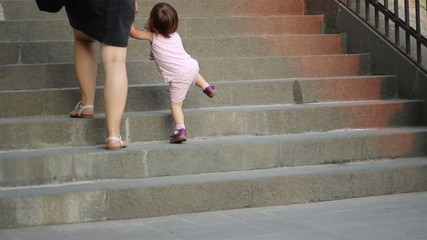 Little Girl Climbing Stairs
