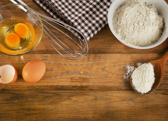 baking ingredients eggs, flour on  wooden background