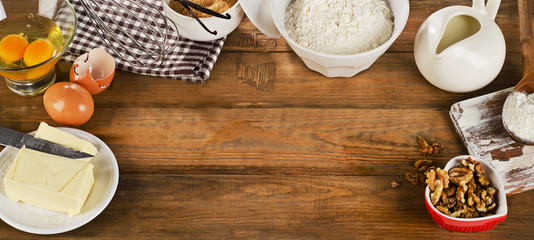 baking ingredients on a wooden background