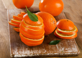 Stack of orange slices on  wooden table