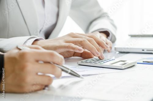 Reviewing financial figure - 79640447