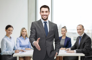 businessman with open hand ready for handshake