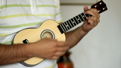 Man Playing Ukulele