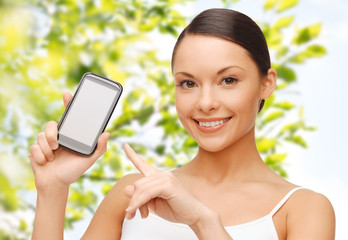happy woman showing smartphone blank screen