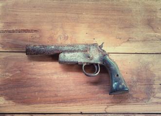 Hand shot gun , old shot gun on the wooden board