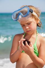 Girl with sea hedgehog