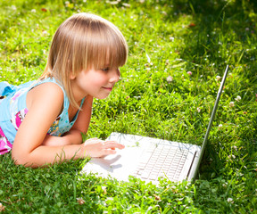 Child with computer outdoor