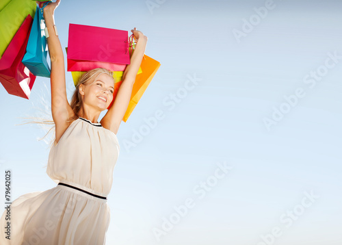 woman with shopping bags - 79642025