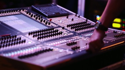 Audio Mixing Console with Audio Engineer in front during Show