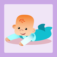 Happy baby is lying on his stomach trying to crawl