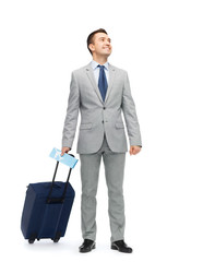 happy businessman in suit with travel bag